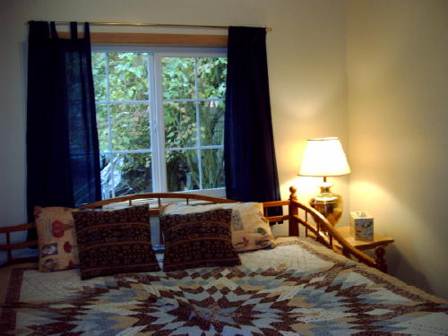 Picture of the east bedroom with a king bed.  Also available in twin beds